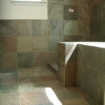 Slate kerdi master bathroom floor with in-floor heating