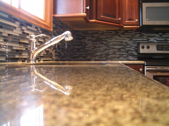 Grey stack glass tile backsplash
