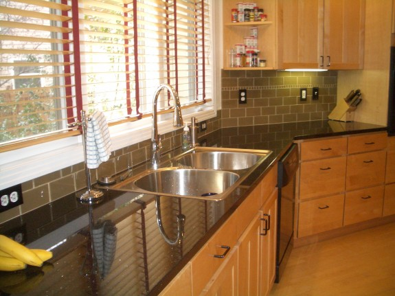 Khaki glass subway tile kitchen backsplash