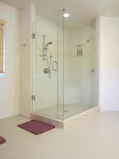 Porcelain and limestone master shower in Boulder, Colorado