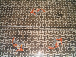 marble mosaic shower floor with koi inlays