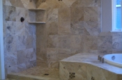 Travertine and glass Master bathroom shower tile in Windsor, Colorado