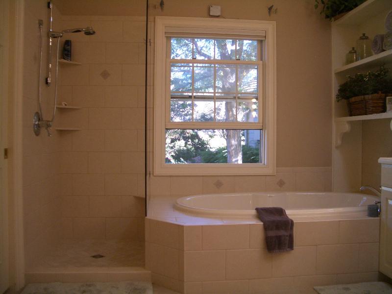 Ceramic master bathroom shower and tub deck installation in Fort Collins