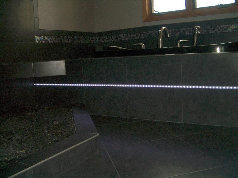Porcelain and glass master bathroom tile installation in Loveland