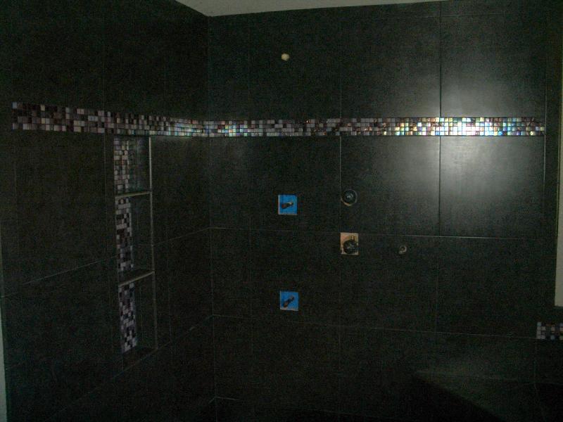Porcelain and glass master bathroom shower tile installation in Loveland, Colorado