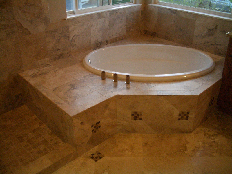 Travertine and glass master bathroom tile installation in Windsor, Colorado