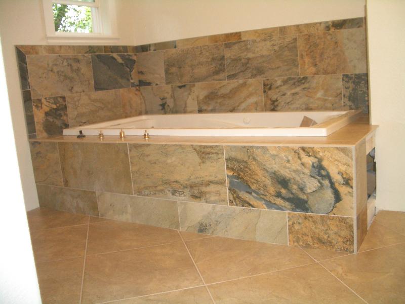 Porcelain master bathroom tub deck tile installation in Fort Collins, Colorado