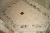 Porcelain master bathroom steam shower floor tile installation in Fort Collins, Colorado