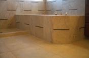 Porcelain and glass master bathroom tub tile installation in Windsor, Colorado