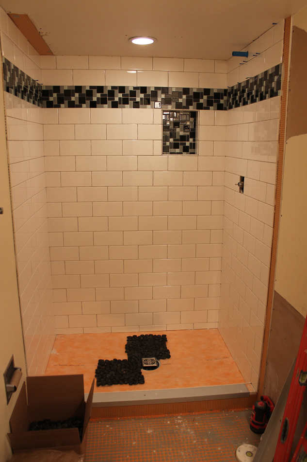 Subway shower with river rock floor