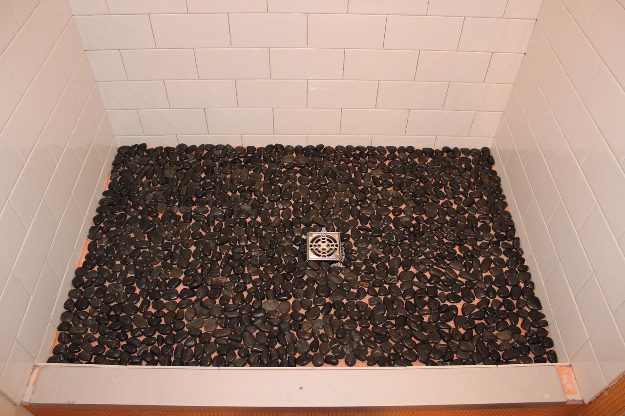 River rock mosaics on shower floor