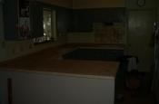 Kitchen Granite Tile Countertop and Glass Backsplash edging