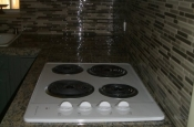 Kitchen Granite Tile Countertop and Glass Backsplash end 2