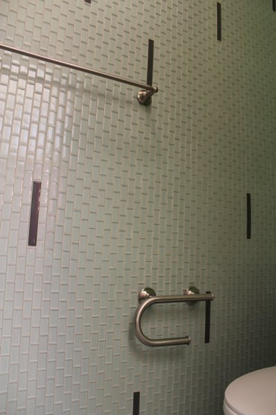Complete glass mosaic tile wall in master bathroom
