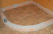Porcelain shower floor with linear drain