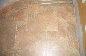 Porcelain pinwheel shower floor with Schluter tile-in linear drain