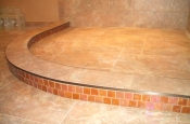 Porcelain shower floor with glass accent curb ready for glass block