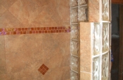 Porcelain master bathroom with glass inserts in Fort Collins