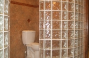 Large curved glass block walls in master bathroom