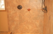 Porcelain master bathroom with glass inlay in Fort Collins