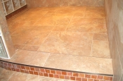 Taconic slate master bathroom shower with glass inlaid curb