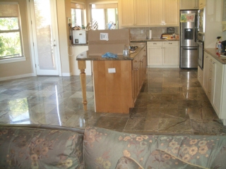 Rainforest green kitchen floor tile installation with in-floor heat