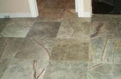 Large format marble tile floor installation