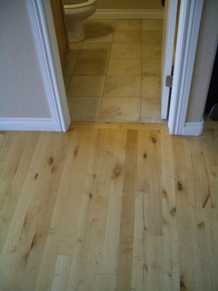 Wood and bathroom ceramic floor before marble installation