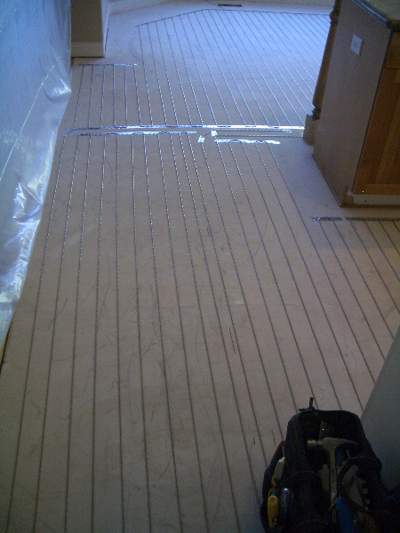 Suntouch in-floor heating element beneath marble tile installation