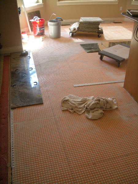 Laying out marble tile installation with in-floor heat