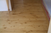 Wood floor before marble installation