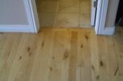 Wood and bathroom ceramic floor before marble installation
