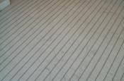 Suntouch in-floor heating element beneath marble tile installation