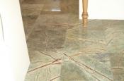 Marble floor tile installation in kitchen