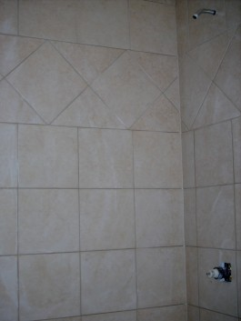 Completed shower tile with row on point in bathroom remodel in Fort Collins