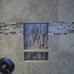 Glass tile built-in niche in master shower remodel