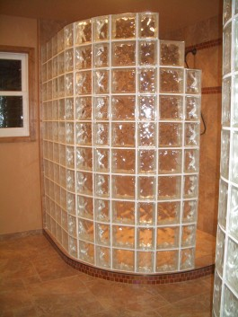 Curved glass block shower wall in master bathroom